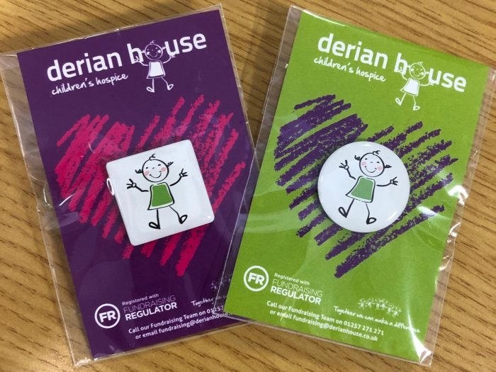 derian house pin badges