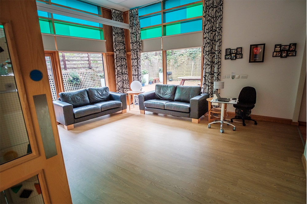Lounge with large TV and 3 games consoles